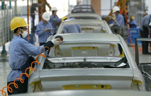 20家主流上市車企的債務數據顯示,2018年總負債破兆至1兆1,570億元人民幣,創下史上負債總額的新高。(China Photos/Getty Images)