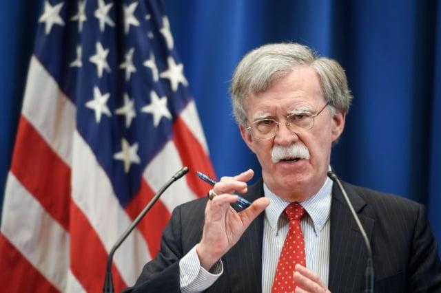 外媒披露,川普與波頓在一系列國家安全問題上有分歧。(Fabrice COFFRINI / AFP)