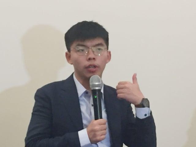 香港眾志祕書長黃之鋒表示,數十年前台灣民眾為爭取自由奮戰、犧牲的經驗,讓香港民眾印象深刻。(中央社)