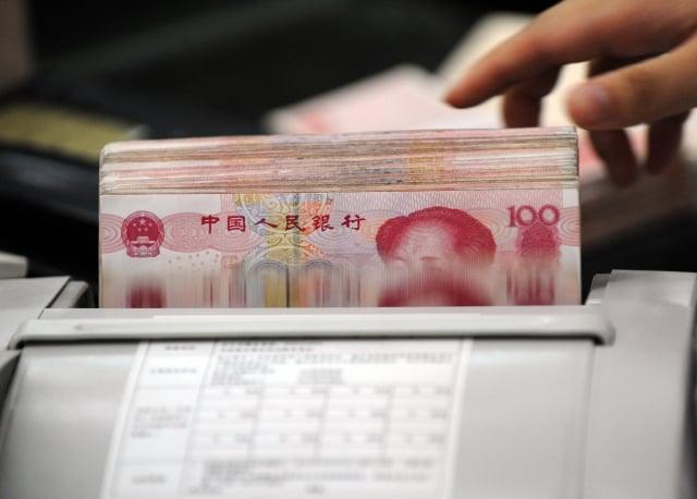 北京日前針對變相公款旅遊進行專項整治運動,專家表示,中共國庫已近空虛,正想盡一切辦法搜刮錢財。(AFP)