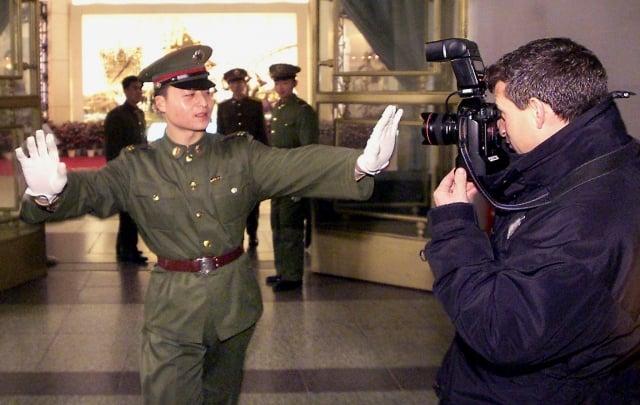 中國國家主席習近平出訪澳門,當地的新聞工作者罕有地受到了恐嚇和警告。示意圖非當事者。(AFP)