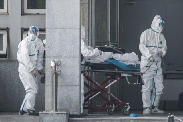 武漢肺炎被感染和死亡的真實數據,遠遠超出中共公布的數字。圖為1月22日武漢金銀潭醫院。(STR/AFP via Getty Images)
