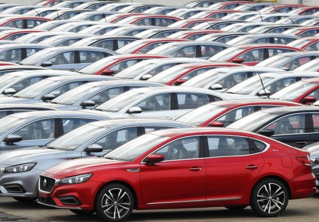新型冠狀病毒肆虐中國大陸,給汽車業帶來衝擊。(STR/AFP via Getty Images)