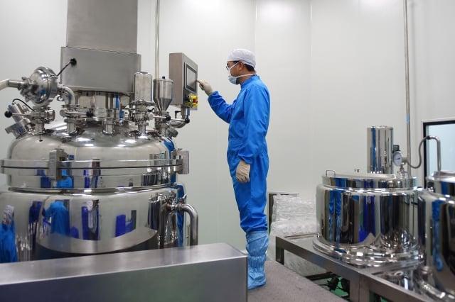 一項新研究表明,武漢肺炎爆發可能影響到全球500多萬家企業。圖為示意圖。(NHAC NGUYEN/AFP via Getty Images)