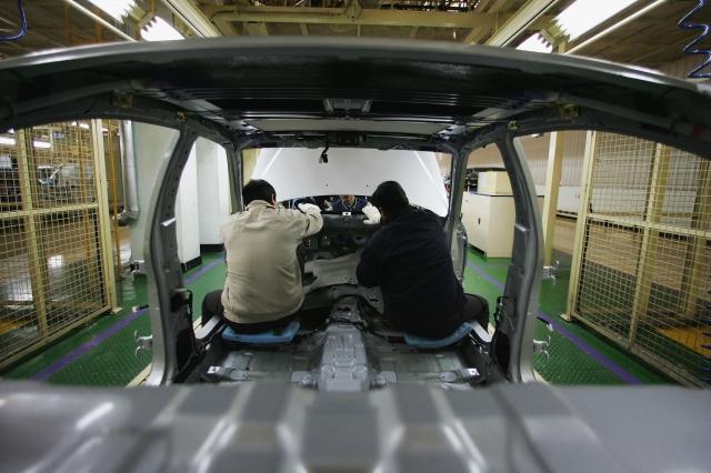 圖為韓國的汽車工廠。(Andrew Wong/Getty Images)