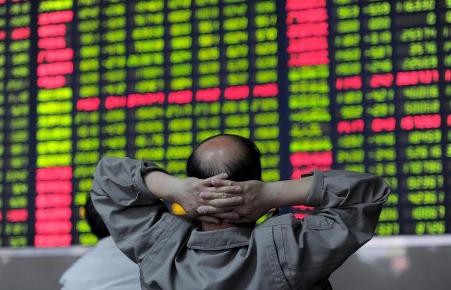 上證綜指時隔3個多月重回3千點,似乎顯示中國經濟回暖,專家卻示警「勿被假象騙了」。示意圖。(Getty Images)