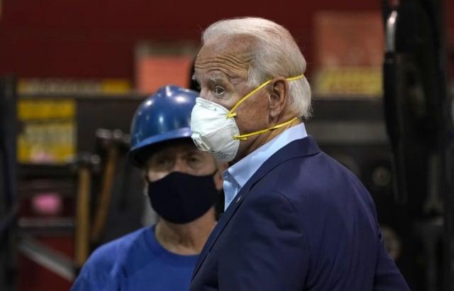 美國現任總統川普(左)與民主黨總統候選人拜登(右)的競選策略受到關注。(AFP via Getty Images)