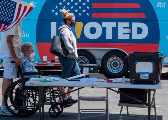 美國人常說「沉默的大多數」才是決定大選結果的主導因素,而不是民調數據。美國選舉示意圖。(AFP via Getty Images)