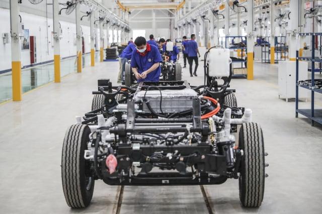 脫離中國供應鏈已是必然趨勢,臺廠一定要升級轉型,拉大領先大陸廠的差距。(STR / AFP via Getty Images)