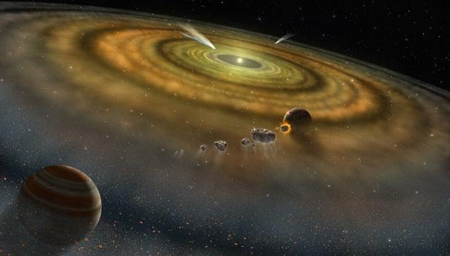 類似太陽系的恆星系統中的氣體與塵埃形成行星的藝術設想圖。(NASA)