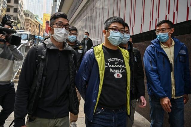 圖中為被捕的鍾錦麟。(PETER PARKS/AFP via Getty Images)
