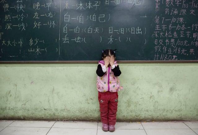 中共近年來更加嚴格地控制教育系統。示意圖。(Kevin Frayer/Getty Images )