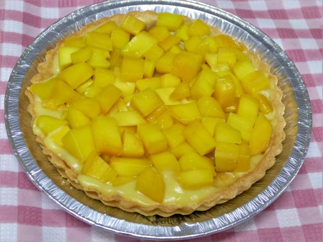 芒果派,鋪滿浸泡過檸檬汁的芒果丁。(攝影/賴瑞)
