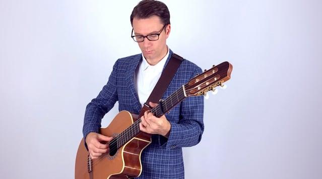帕特里克(Patrick),是「臨時居民」(The Temporary Residents)樂隊的主奏吉他手和聯合創始人。(臨時居民樂隊提供)