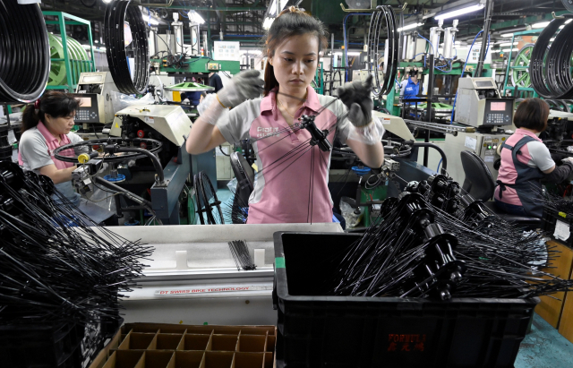 2021年製造業成長率為10.03%,產值來到新臺幣20.92兆元。(SAM YEH/AFP via Getty Images)