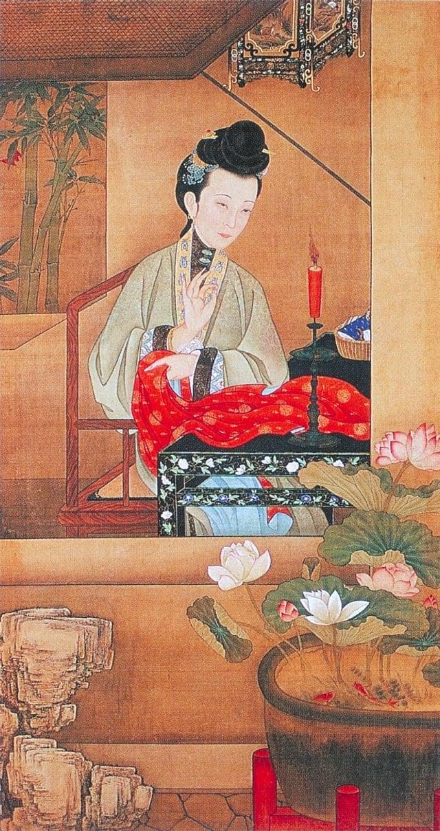 5.清.佚名,絹本《雍正十二美人圖》-燭下縫衣(維基百科)