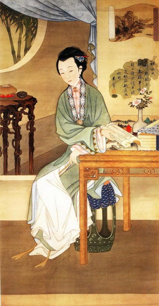 清.佚名,絹本《雍正十二美人圖》,觀書沉吟。(維基百科)