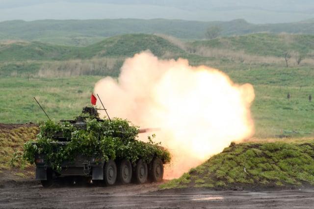中共的數百個核飛彈發射井曝光後,專家警告,美國需要備戰,因為中共正準備與美國作戰。圖為日本軍事演習資料照。(Akio Kon - Pool/Getty Images)