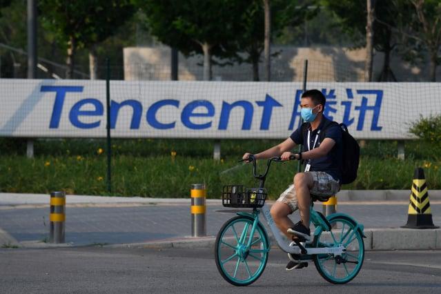 騰訊與蝦皮母公司冬海集團的創辦人李小冬極為密切。(GREG BAKER/AFP via Getty Images)