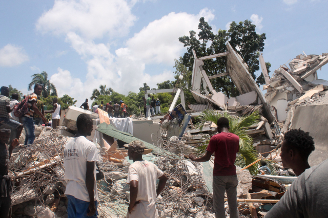 圖為海地的地震災情。(STANLEY LOUIS/AFP via Getty Images)