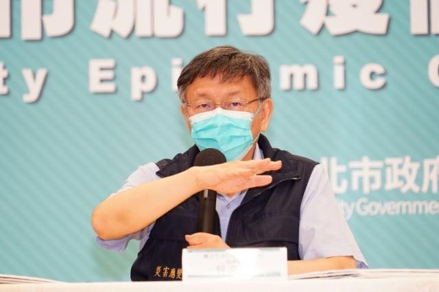 臺北市長柯文哲18日表示,職場感染恐是北市面臨的新難題,若在不影響工作效率的情況下,建議企業安排分流居家辦公。(臺北市政府提供)