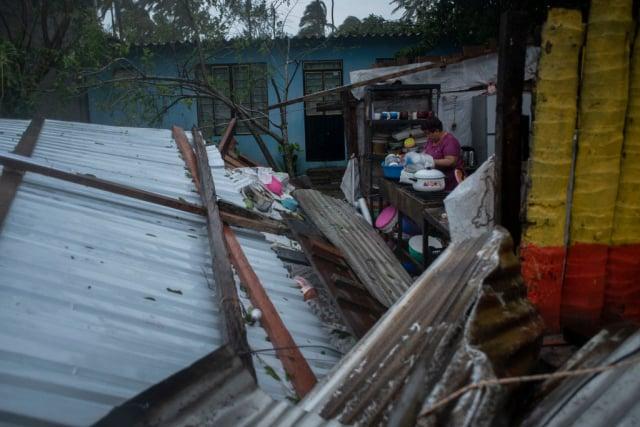 颶風葛瑞斯8月21日登陸墨西哥,引發洪水並破壞房屋。(VICTORIA RAZO/AFP via Getty Images)
