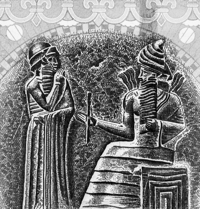 圖為漢摩拉比從太陽神手中接過權杖。(Shutterstock)