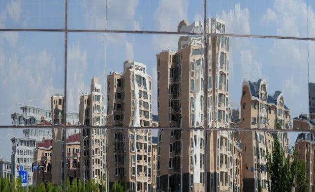 陸媒統計,今年以來已有274家房地產公司發布破產文書,平均一天一家。示意圖。(AFP)