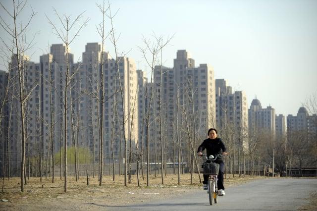 澳盛銀行指出,除了深陷財務困境的中國恆大集團,不排除中國還有一些大型房企可能面臨流動性危機。圖為示意圖。(Photo credit should read LIU JIN/AFP/Getty Images)