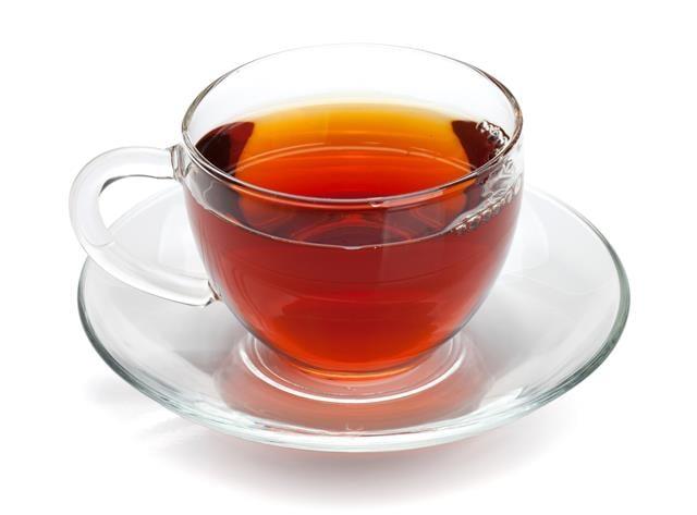佳節後產生的身體病痛與身材問題,除了按摩穴道之外,適度喝茶有利於食物消化、消除腸胃油膩。(123RF)