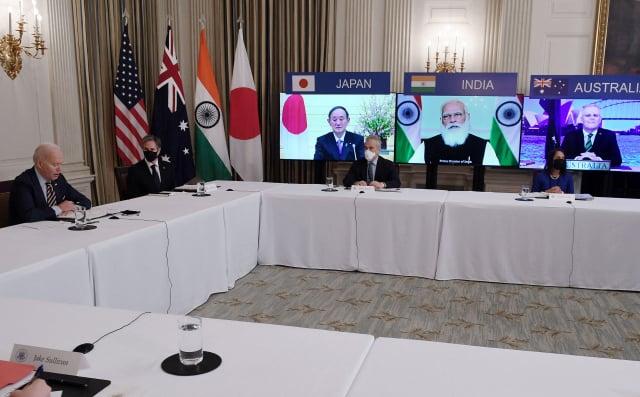 圖為美澳日印四國領導人在3月出席「四方會談」的在線會議。(STR/AFP via Getty Images)