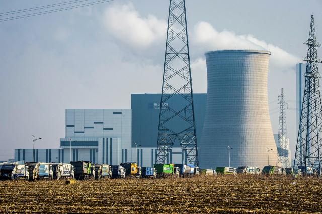 圖為中國的火力發電廠。( STR/AFP via Getty Images)