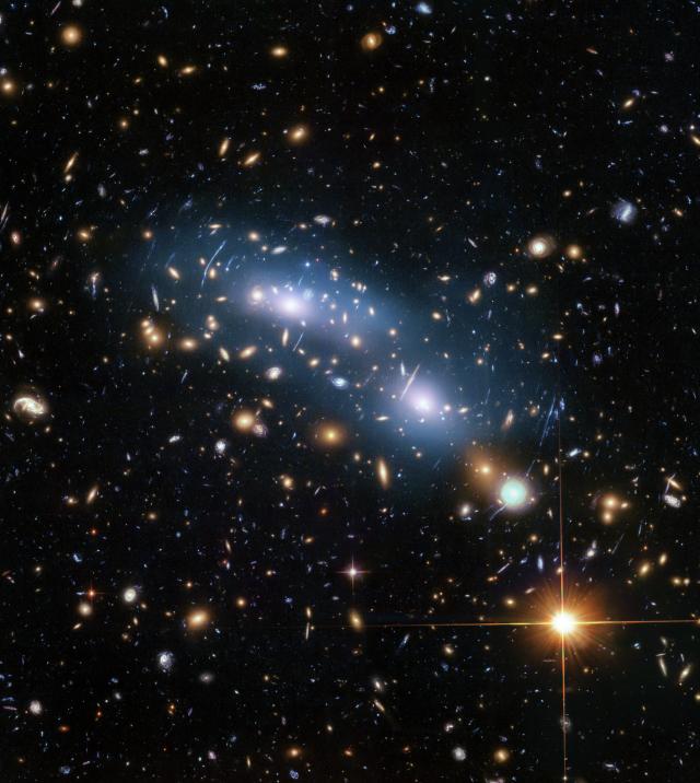 星系被厚重的塵埃遮蓋住,被忽略它的存在(示意圖)。(NASA)